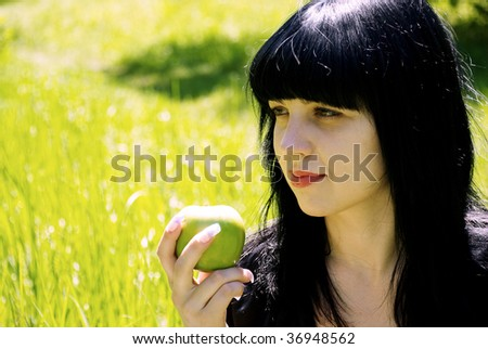 Young beautiful woman in nature