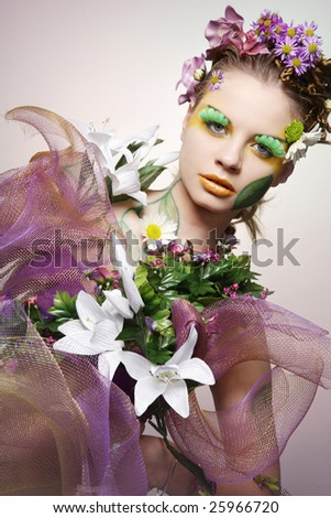 Young beautiful woman in pink and white flowers. - stock photo