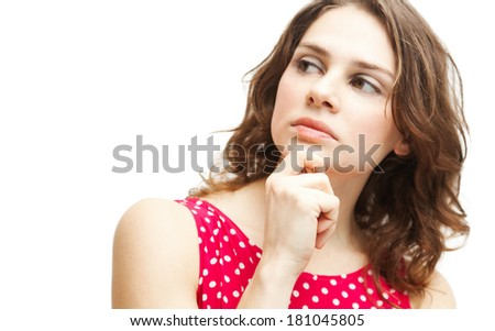 young beautiful woman in red blouse thought, isolated on white  - stock photo