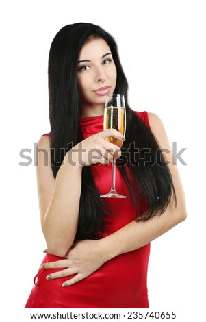 Young beautiful woman in red dress with a glass of champagne - stock photo