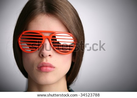 young beautiful woman in red strips sunglasses - stock photo