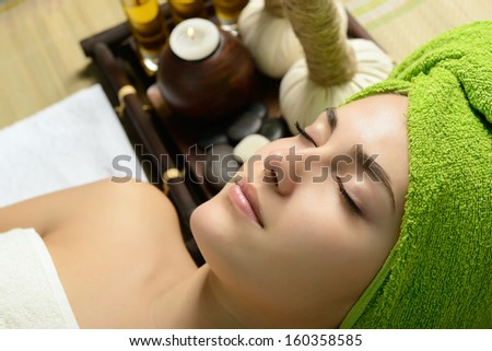 Young beautiful woman in spa gets a facial massage  - stock photo
