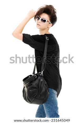 young beautiful woman in sunglasses, with black leather handbag, - stock photo