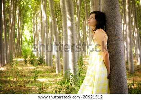 Young beautiful woman in the forest. - stock photo