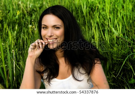 young beautiful woman in the green field