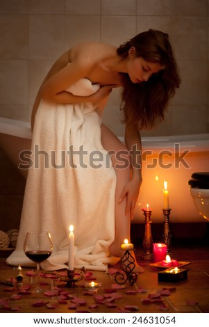 Young beautiful woman in the retro bathroom - stock photo