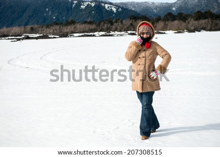 Young beautiful woman in the snow - stock photo