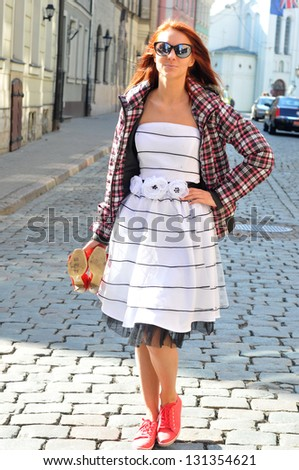 Young beautiful  woman in the street - stock photo
