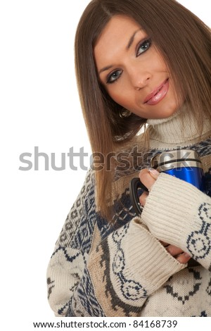 young beautiful woman in warm sweater with big blue cup - stock photo