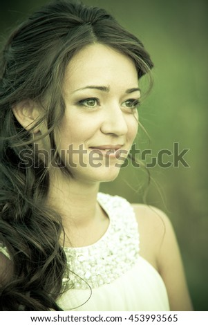 Young beautiful woman in white dress on nature
