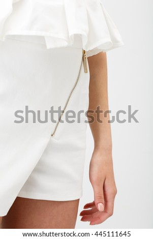 Young beautiful woman in white shorts on white background
