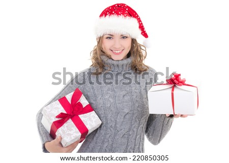 young beautiful woman in winter clothes and santa hat with christmas presents isolated on white background