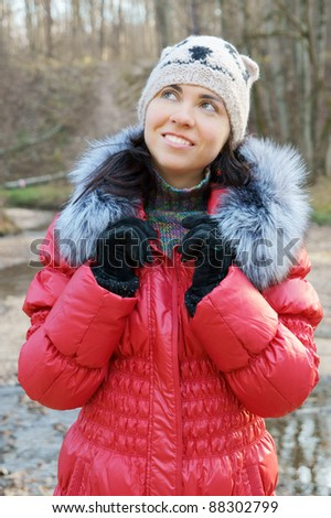 Young beautiful woman in winter overclothes outdoor