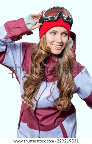 Young beautiful woman in winter sport clothes isolated on light background
