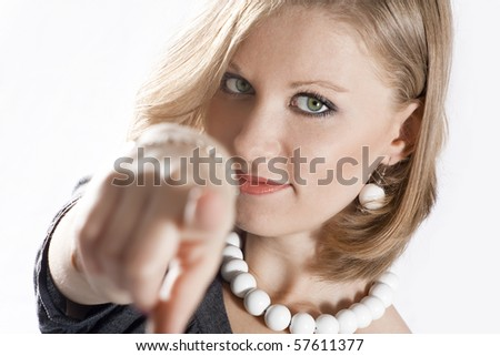 Young beautiful woman is pointing at you with blurred hand - stock photo