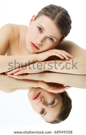young beautiful woman is reflected even - stock photo