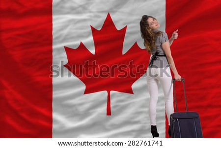 young beautiful woman is traveling to canada - stock photo