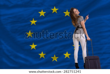 young beautiful woman is traveling to europe - stock photo