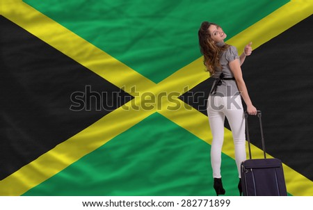 young beautiful woman is traveling to jamaica - stock photo