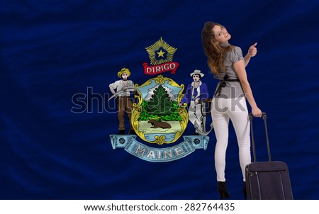young beautiful woman is traveling to maine - stock photo