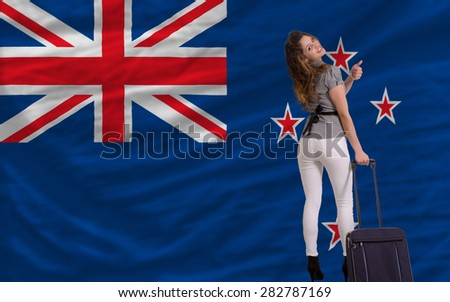 young beautiful woman is traveling to new zealand - stock photo
