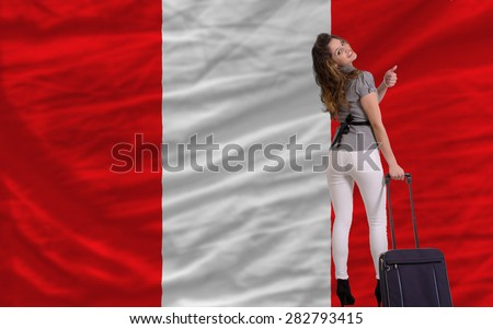 young beautiful woman is traveling to peru - stock photo