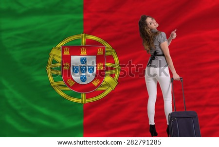 young beautiful woman is traveling to portugal - stock photo