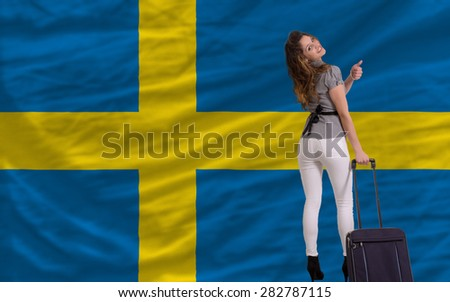 young beautiful woman is traveling to sweden - stock photo