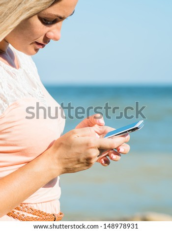 young beautiful woman is using a smartphone