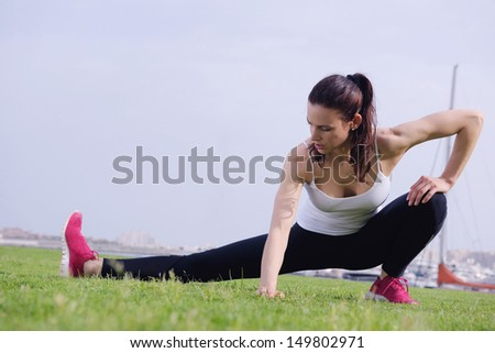 Young beautiful  woman jogging and running  on morning at  park in the city. Woman in sport outdoors health and fitness concept - stock photo