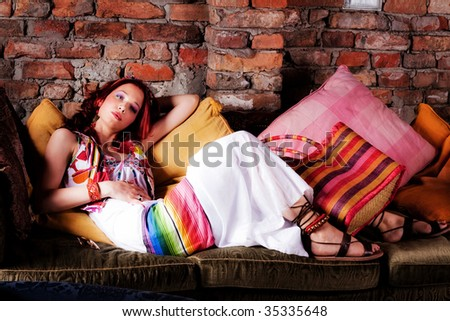 young beautiful woman lie down in sofa