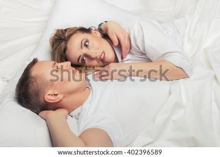 Young beautiful woman lies on the man's shoulder.