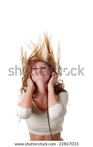 young beautiful woman listening music with headpfones - stock photo