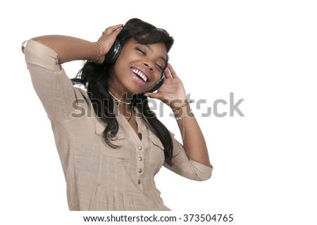 Young Beautiful Woman listening to a set of headphones - stock photo