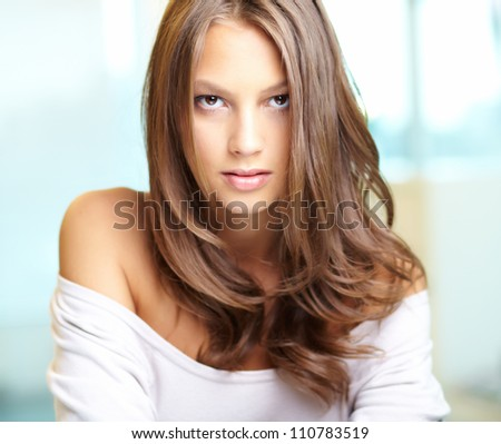 Young beautiful woman looking at camera - stock photo