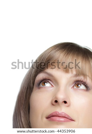 Young beautiful woman looking up into the corner, closeup, isolated on white - stock photo