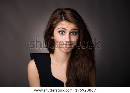 Young, beautiful woman, making a silly face - stock photo