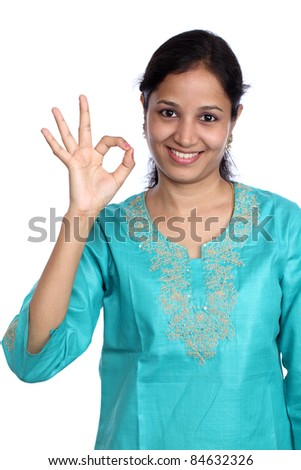 Young beautiful woman making Ok sign - stock photo