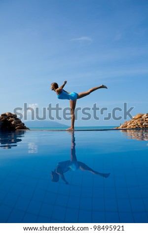 Young beautiful woman making yoga on the beach - stock photo