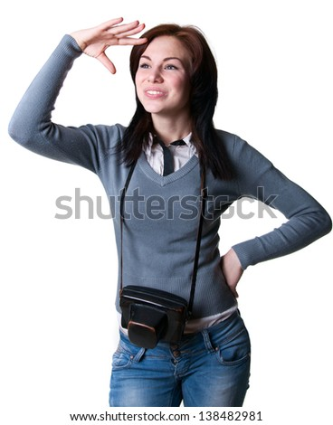 Young beautiful woman model holding her camera in special leather case, looking with anticipation for some places ahead of her to take photos, smiling with toothy smile. Isolated on white, copy space - stock photo