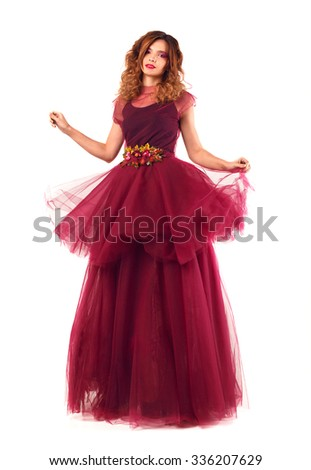Young beautiful woman model in fairy red marsala dress. Isolated on white background.