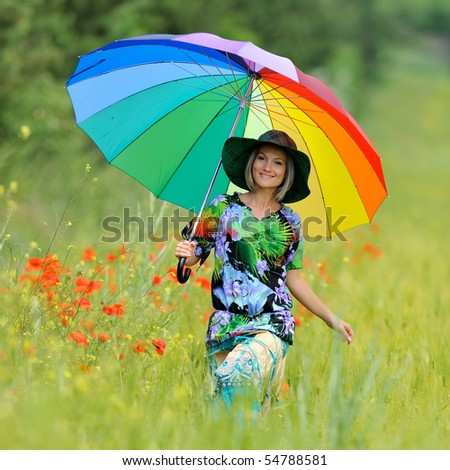 young beautiful woman on cereal field in summer