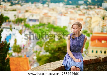 Young beautiful woman on Le Suquet hill in Cannes, France - stock photo