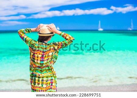 Young beautiful woman on summer vacation at tropical white beach - stock photo
