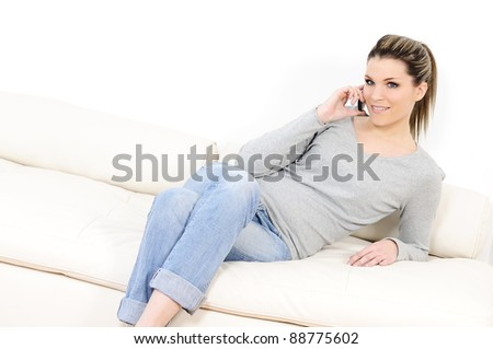 young beautiful woman on telephone in his sofa - stock photo