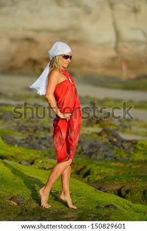 young beautiful woman on the beach in summer - stock photo