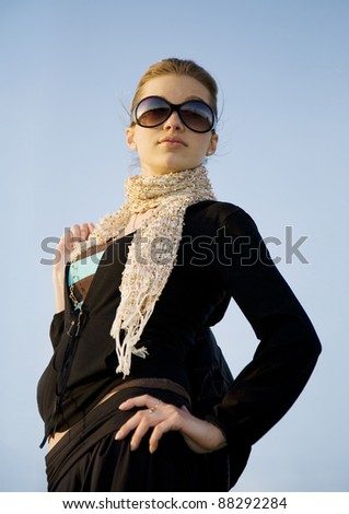 young beautiful woman on the blue sky with copyspace