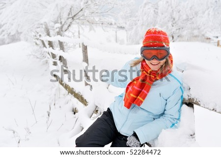young beautiful woman outdoor in the snow