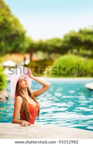 Young beautiful woman outdoors in swimming pool