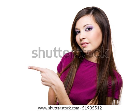 Young beautiful woman points a hand  - isolated on white - stock photo